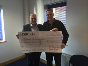 Gareth Herbert collecting cheque from Rokeby Lodge